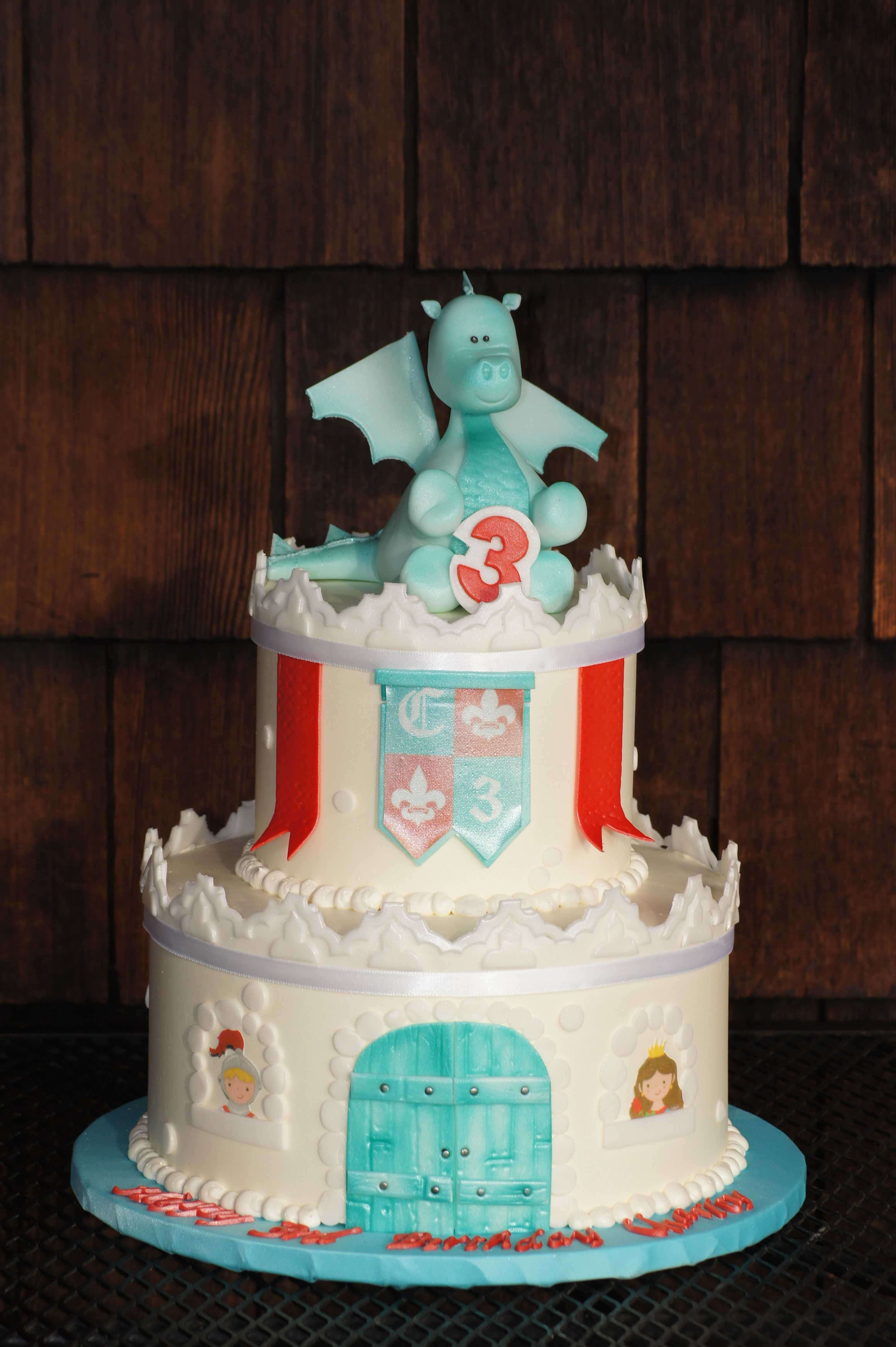 white castle shaped birthday cake with blue dragon topper
