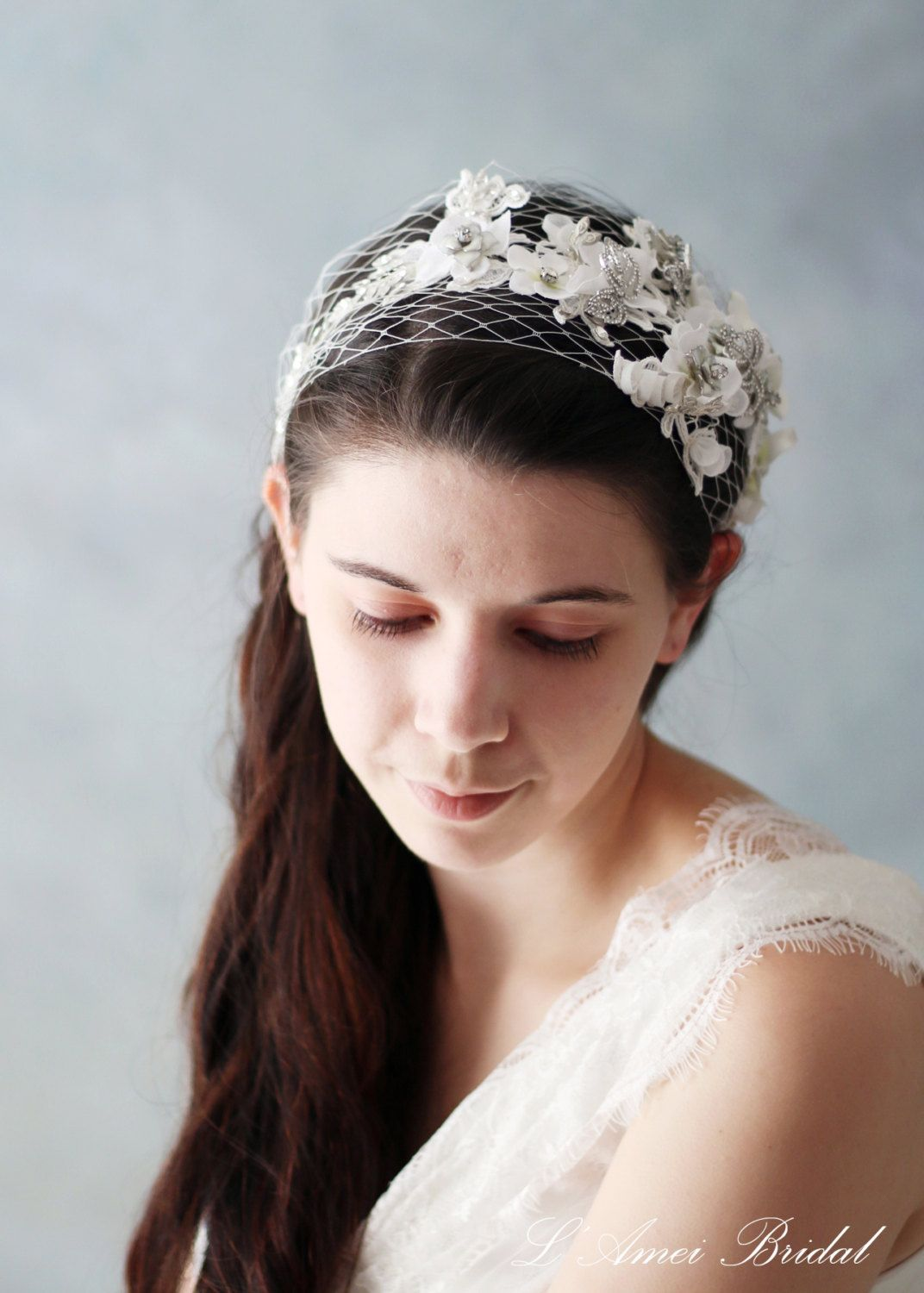 wedding hair band with small white flowers accented with