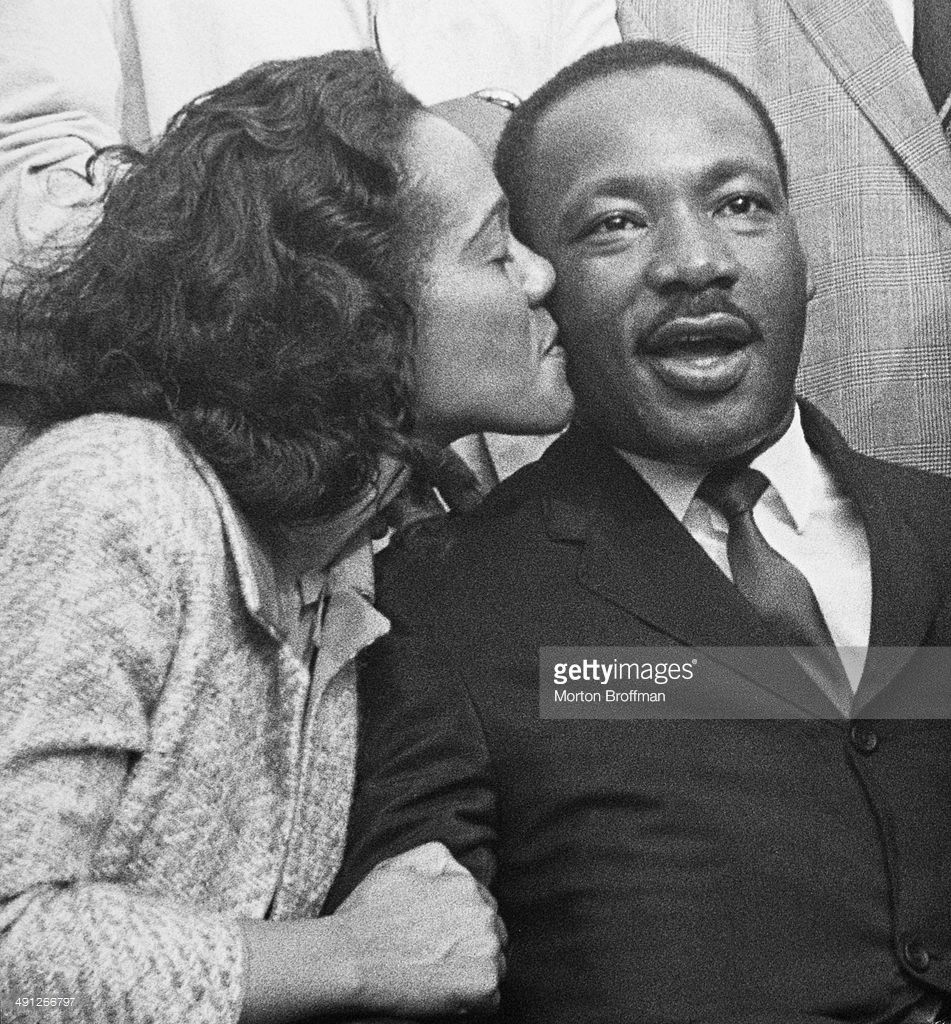 Coretta Scott King kisses her husband, Martin Luther King, Jr., in Montgomery