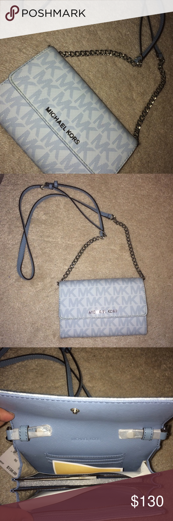 NWT Michael Kors Crossbody Purse Brand new • Never used • Been sitting in my closet • Super cute • Silver and light blue colored Michael Kors Bags Crossbody Bags