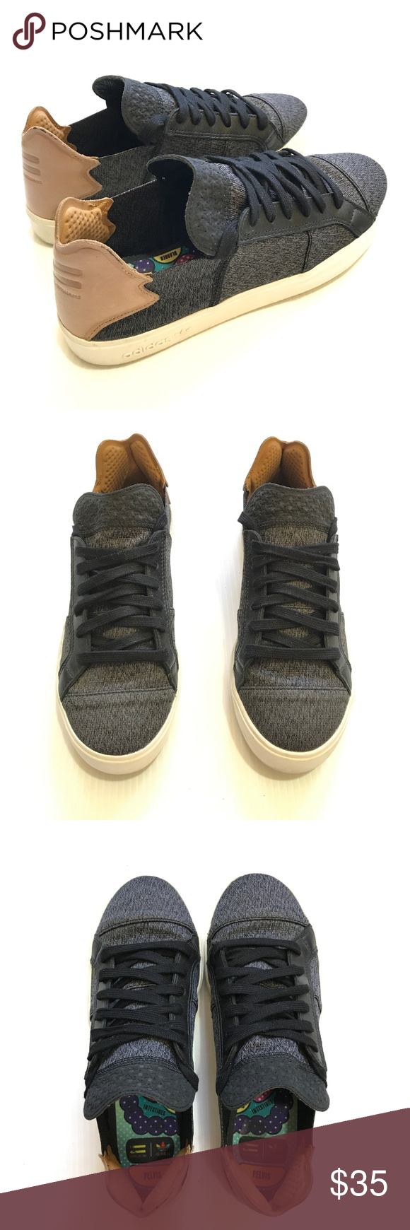 buy popular 324bf e406d Pharrell Williams x Adidas Elastic Lace Up 2024 Woven upper. Marled  blackwhite. Looks grey. Black trim surround the laces.