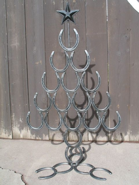 Western Christmas Tree: Sisters Log Furniture, Handcrafted $179.00.. WOW !! now I know what to do with all those old horseshoes!!!