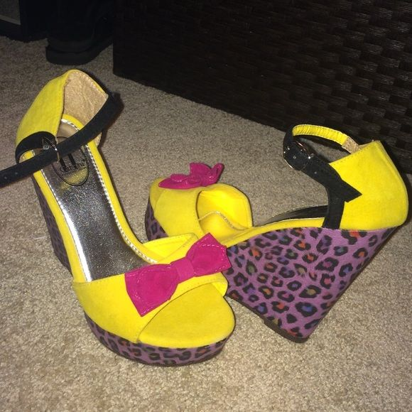 Funky cheetah wedge Fun summer wedge! Purple and rainbow cheetah print, yellow suede and a hot pink bow, with a black ankle strap.. What more could you ask for?! Never worn. Shoes Wedges