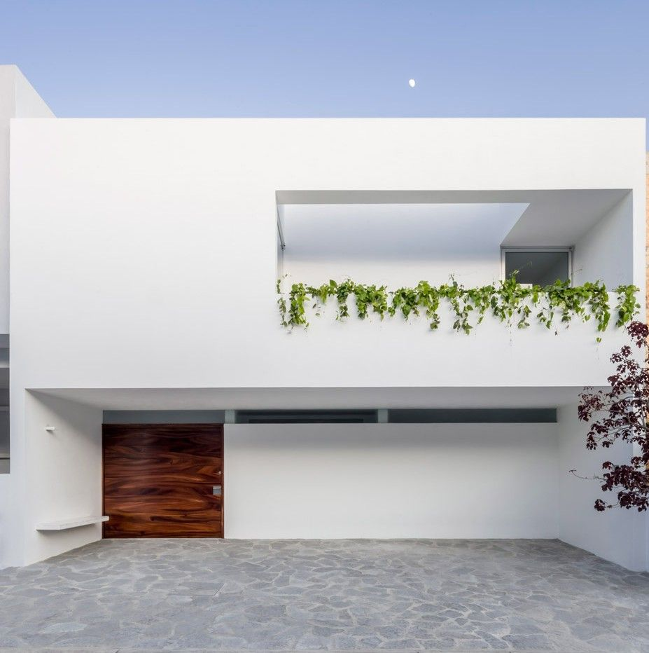 Cross-shaped frame supports double-height window in V House | Window ...
