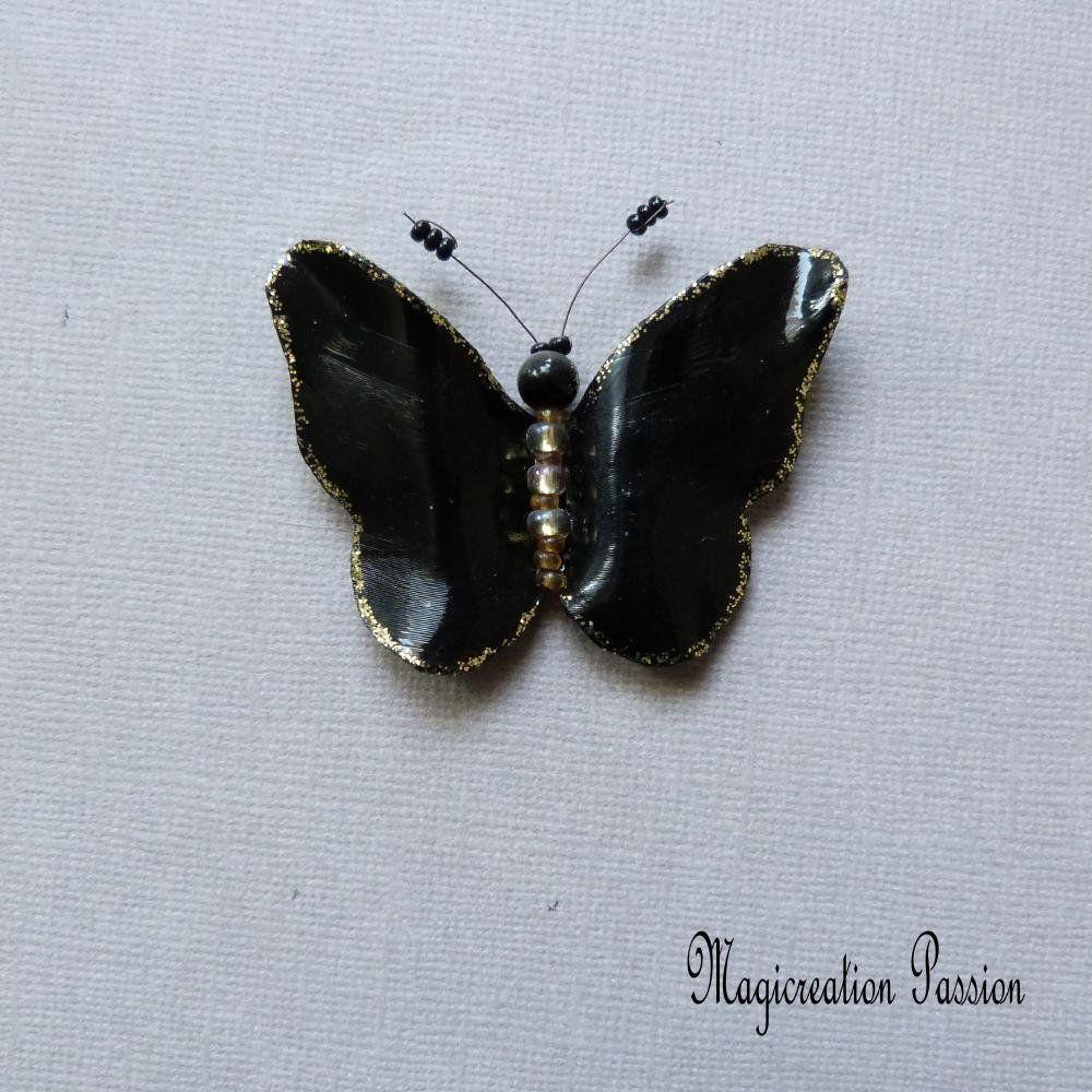 magnet papillon noir et dore vinyle