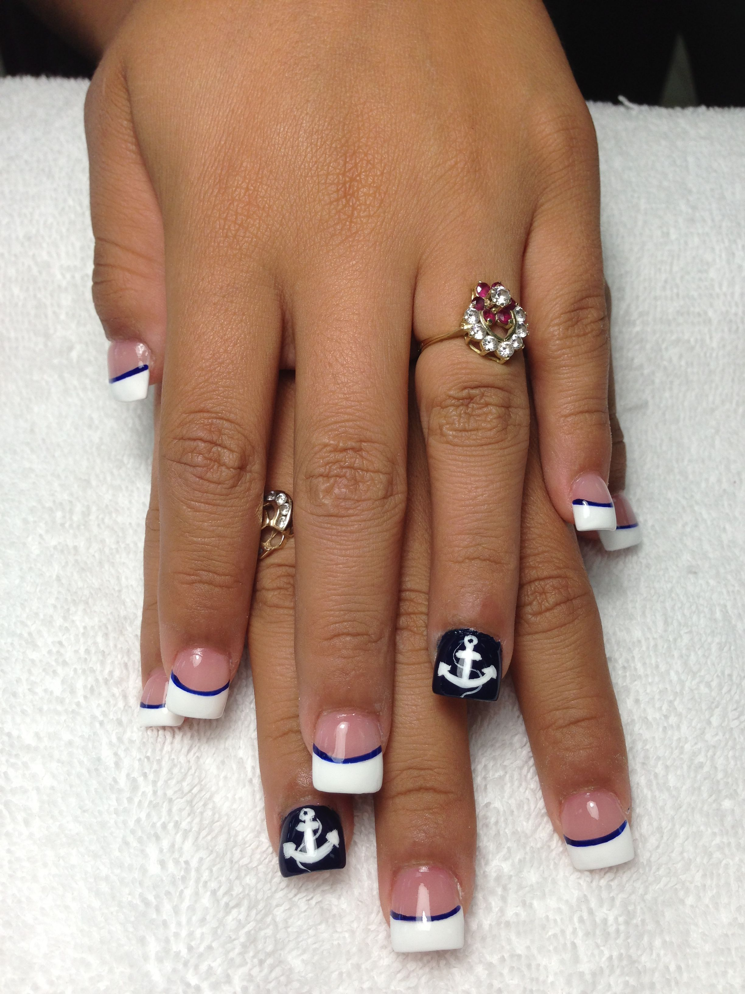 Simple French with a line to separate the tips and show off the ring ...