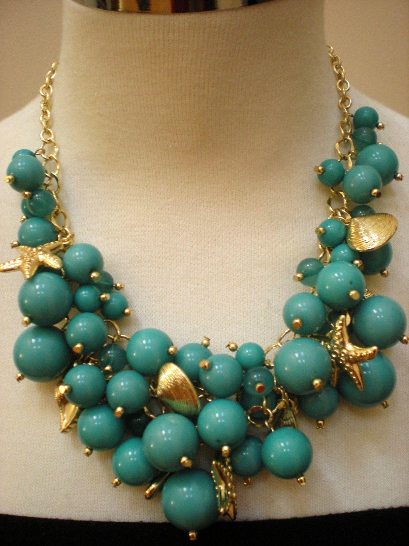 Turquoise & Gold Bib Necklace by JewelrybyMaitri on Etsy
