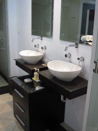 Separate Sinks & Mirrors, But Shared Draws To Create More Space!