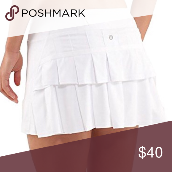 Lululemon Pace Setter Skirt - White Size 6 Solid white color Perfect for running or tennis Cute ruffles on back Small pocket on back  Shorts have sticky non slide hem perfect for active or running wear Luxtreme swift fabric, 4 way stretch with moisture wicking chafe resistant breathable material  Great condition! lululemon athletica Skirts Mini