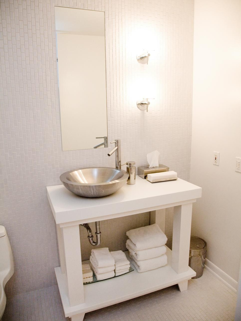 The All White Small Space Bathroom Features Full Length Tile Walls And Flooring The Contemp Small Bathroom Vanities White Vanity Bathroom Traditional Bathroom