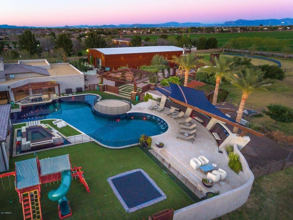 Backyard With Pool, Spa, Trampoline, Batting Cage, Soccer Pitch, And More