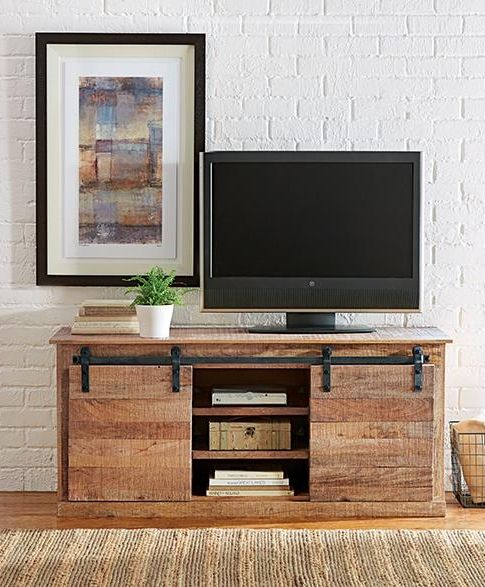 The Holden Media Cabinet has rustic, farmhouse appeal. Made of mango wood and accented with black iron hardware. This media cabinet will hold the TV and store electronics. It has two shelves as well as two sliding doors to hide what's inside! #12DaysofDeals2016