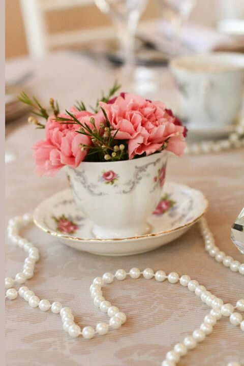 Love This Pearls And Antique Tea Cup With Flowers As Wedding Table Decor Ph Table Arrangements Wedding Tea Cup Centerpieces Bridal Shower Decorations Vintage