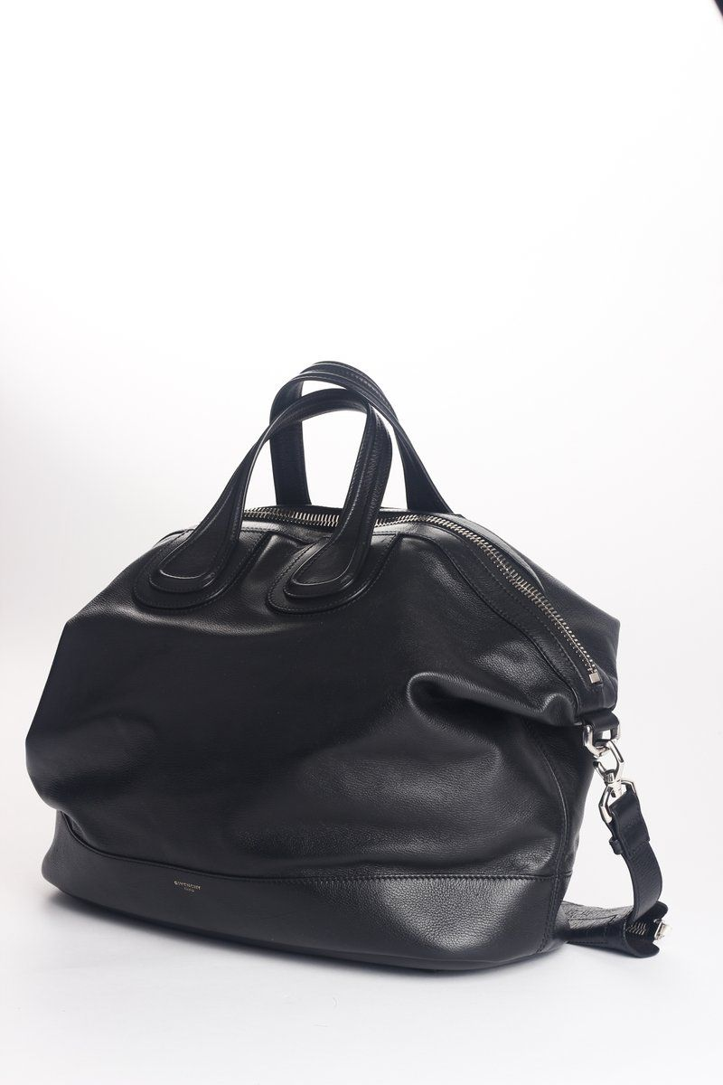 e37f9affb81f Black calf leather  Nightingale  tote from Givenchy featuring a top zip  closure