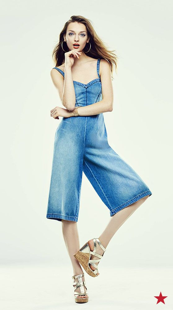 481c5d7744 The GUESS jean jumpsuit features a trendy culotte pant. Your new go-to for  a rooftop party