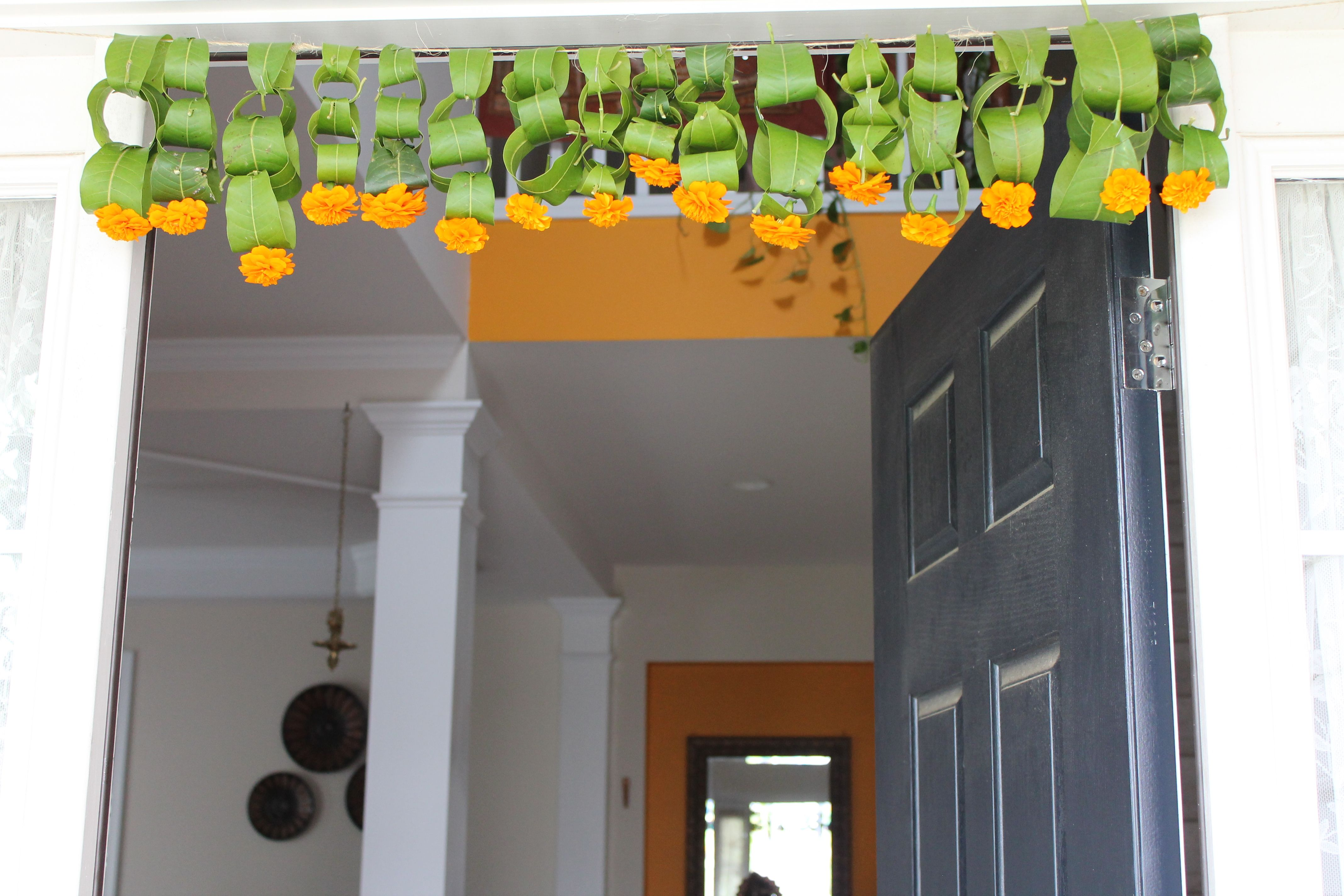 Image result for home decorated with leaves toran,nari