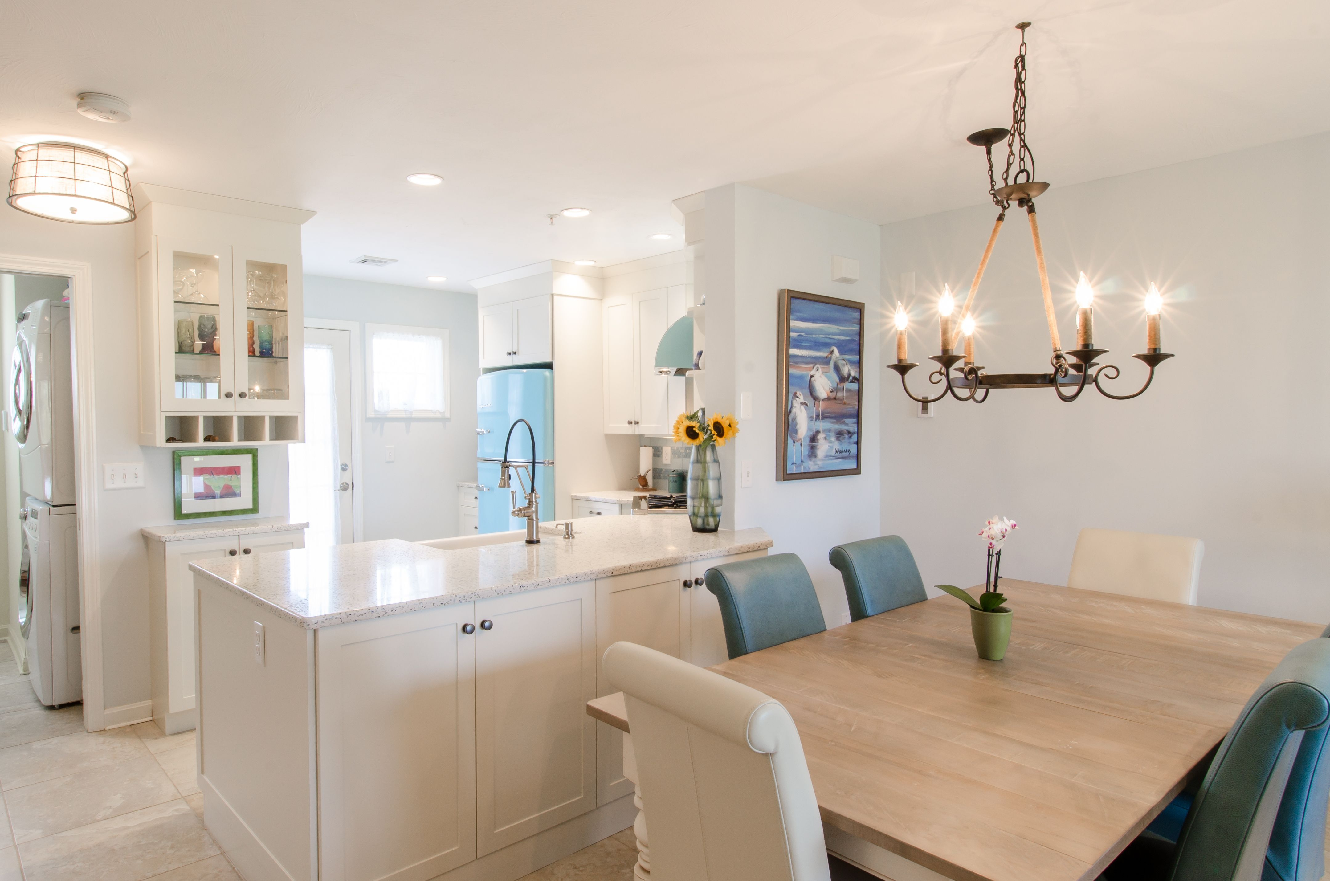 White Kitchen Cabinetry, Retro Blue Appliances, Curava Recycled Glass  Countertop, Farmers Sink