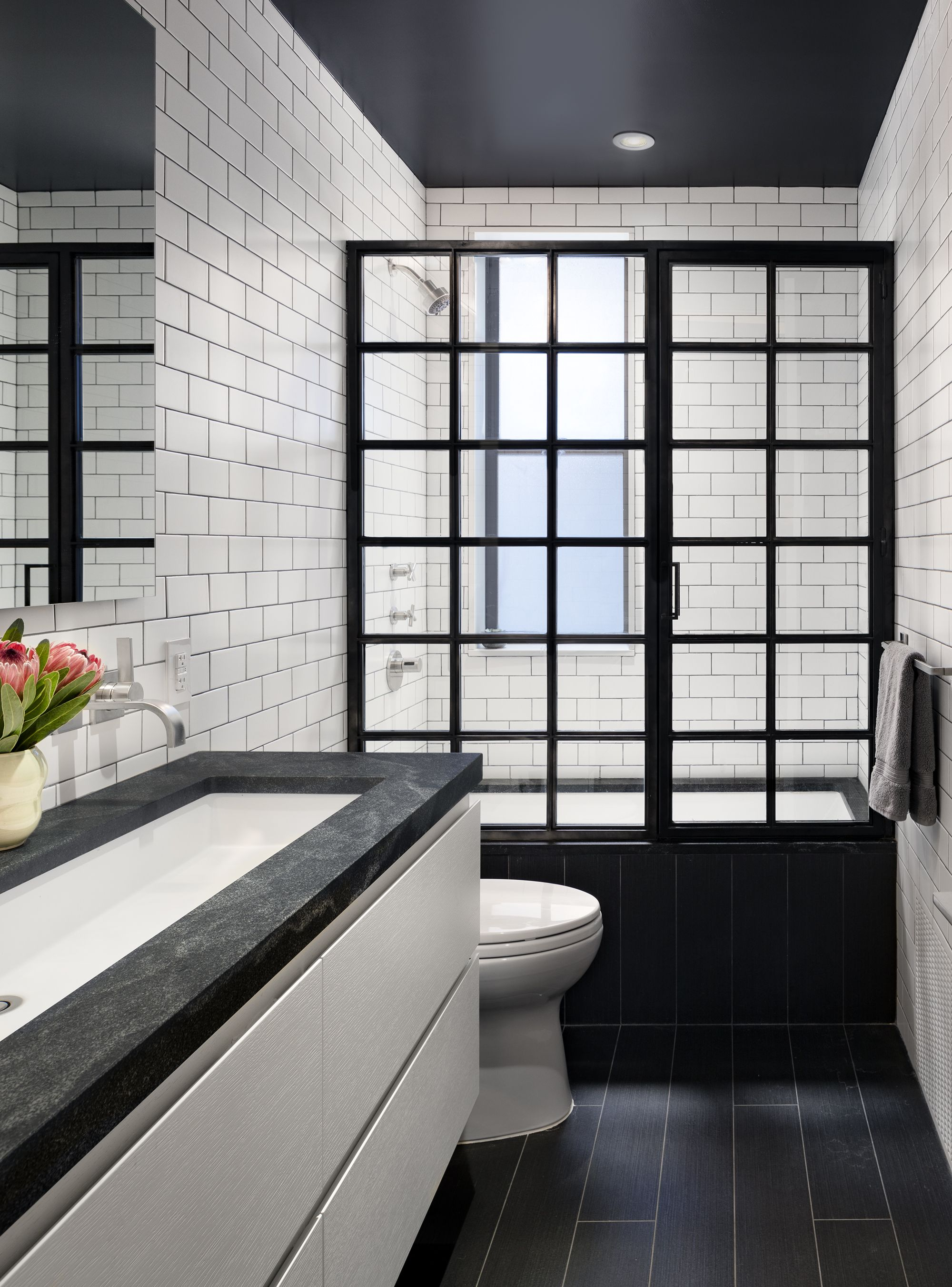 A Steel And Glass Enclosure For The Tub Shower Black Ceiling Master Bathroom Decor Black And White Master Bathroom Shower Remodel