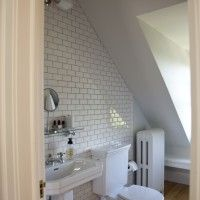 This tucked-away attic bathroom was given a clean, fresh look.