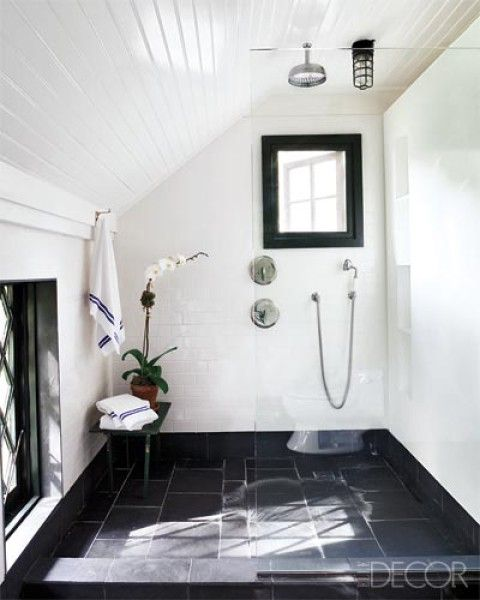 White Walls in the Bathroom: The master bath of a Long Island, New York, home is sheathed in slate floor tiles.