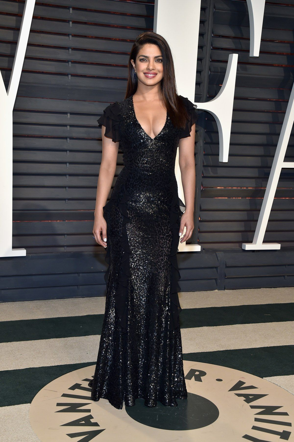 1b4ade2087543 Priyanka Chopra in Michael Kors Collection attends the 2017 Vanity Fair  Oscar Party hosted by Graydon Carter