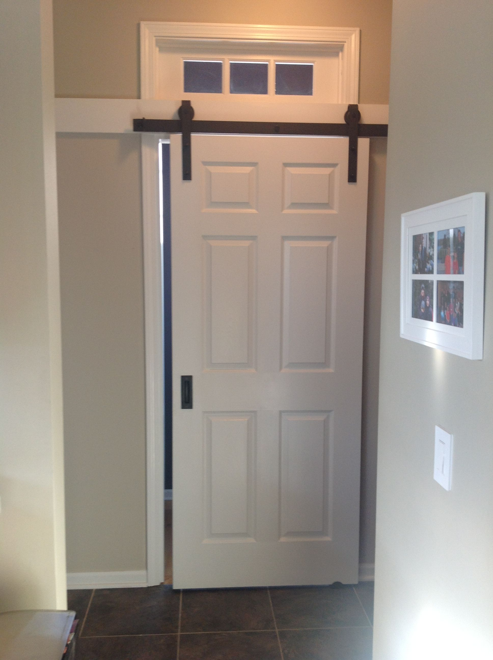 New barn door saves space in the hall Real Carriage Hardware