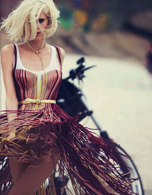 The styling is a bit busy for such a show-stopping fringe dress. Still, it's a show-stopper on its own.