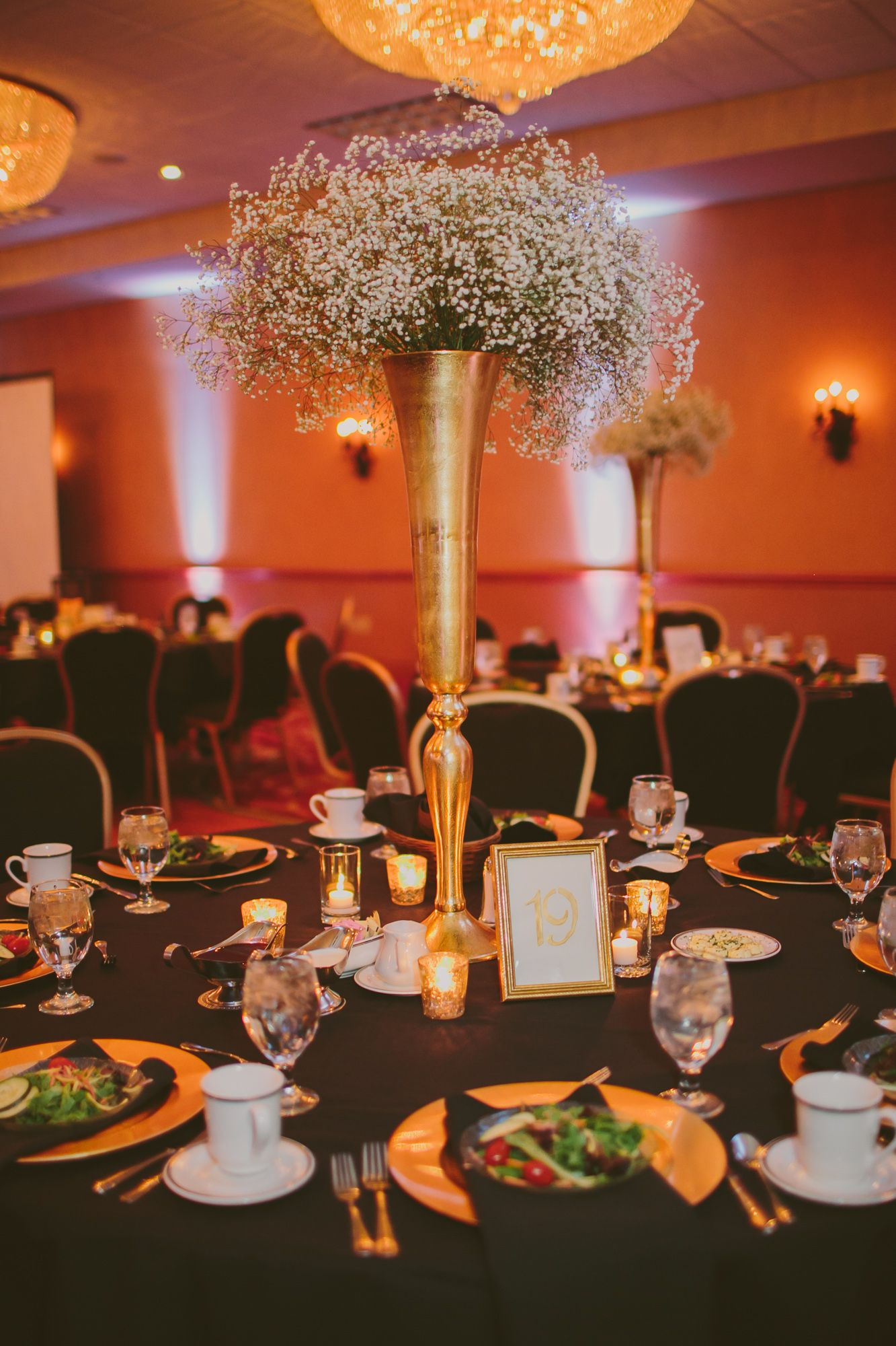 Tall Gold Centerpieces with Baby's Breath at Tundra Lodge