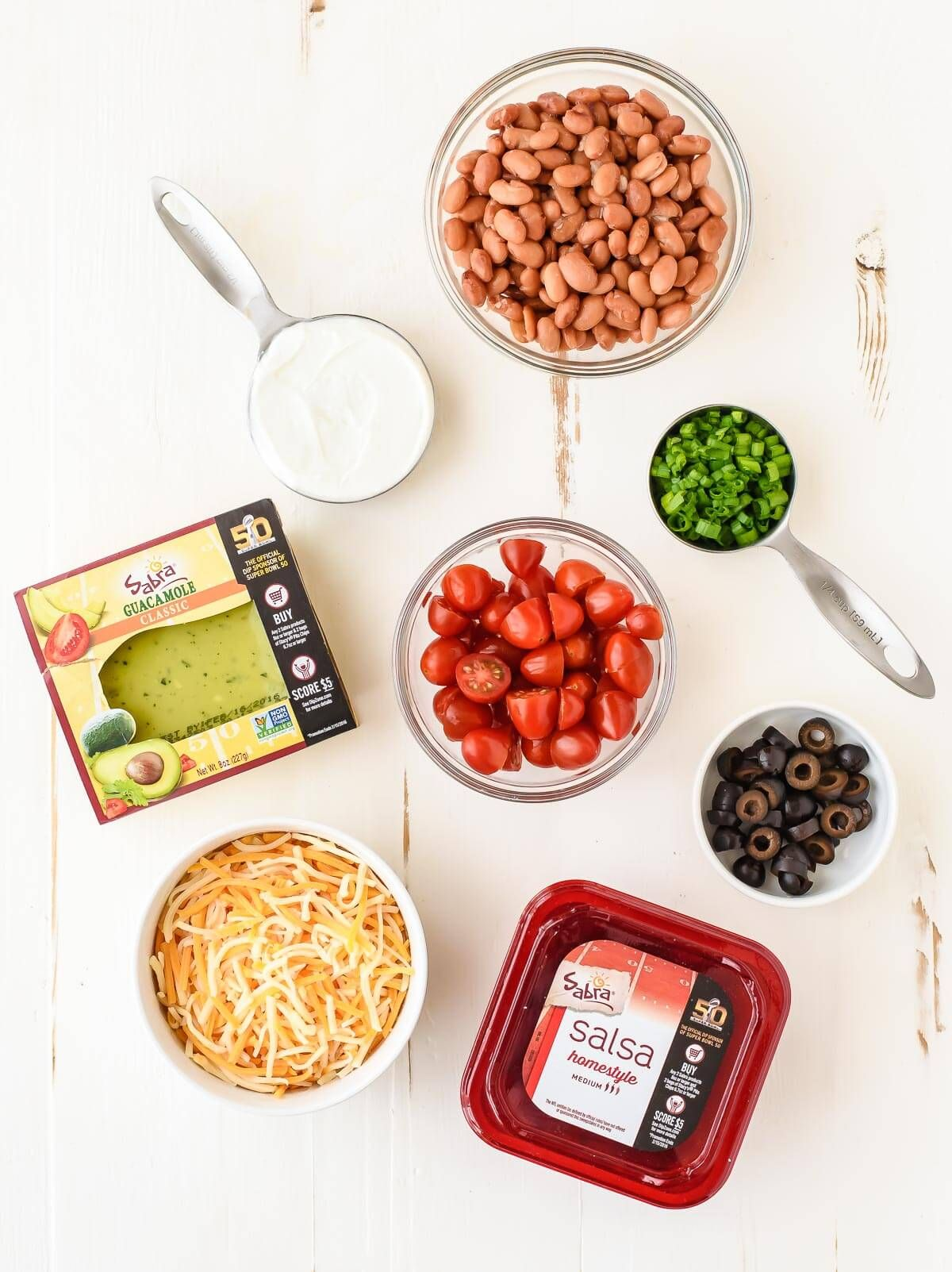 The best Mexican 7 Layer Taco Dip Recipe! Easy to make with fresh ingredients and a few shortcuts too.