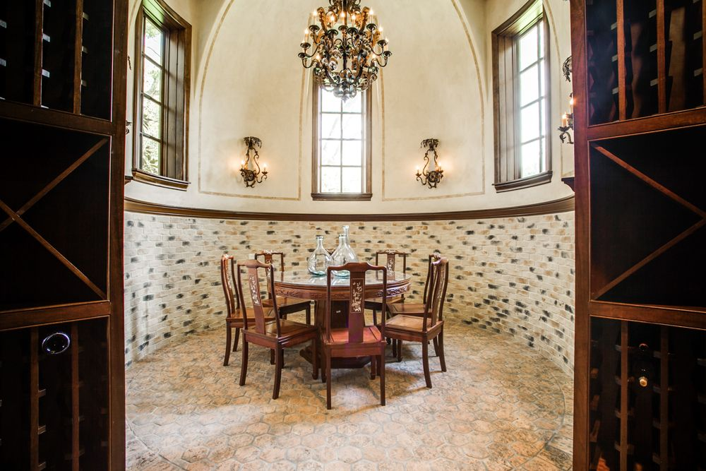 French Renaissance Chateau Style Mansion with Elegant Curb Appeal