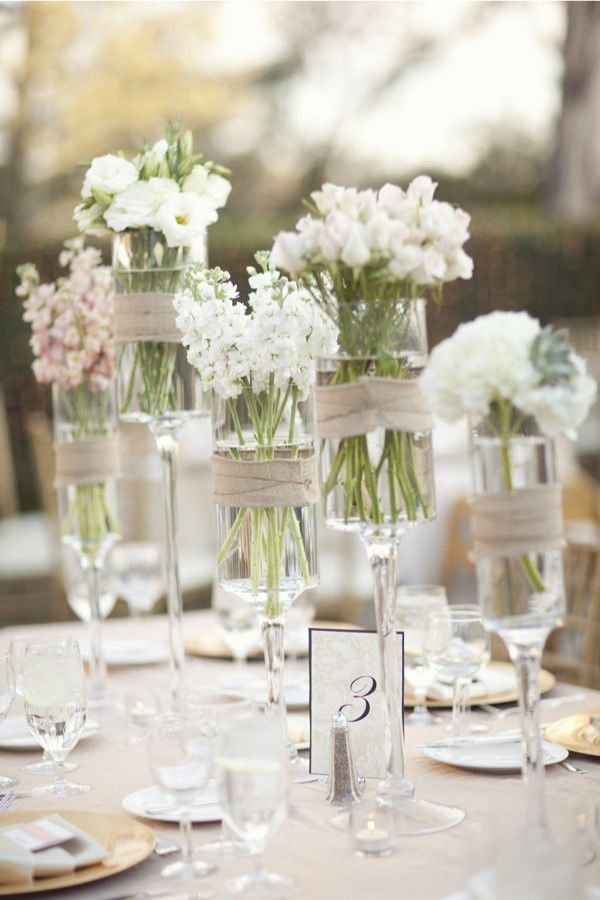 Assorted Wild White Flowers In Tall Stemmed Candle Holders Wrapped With Burlap Wedding