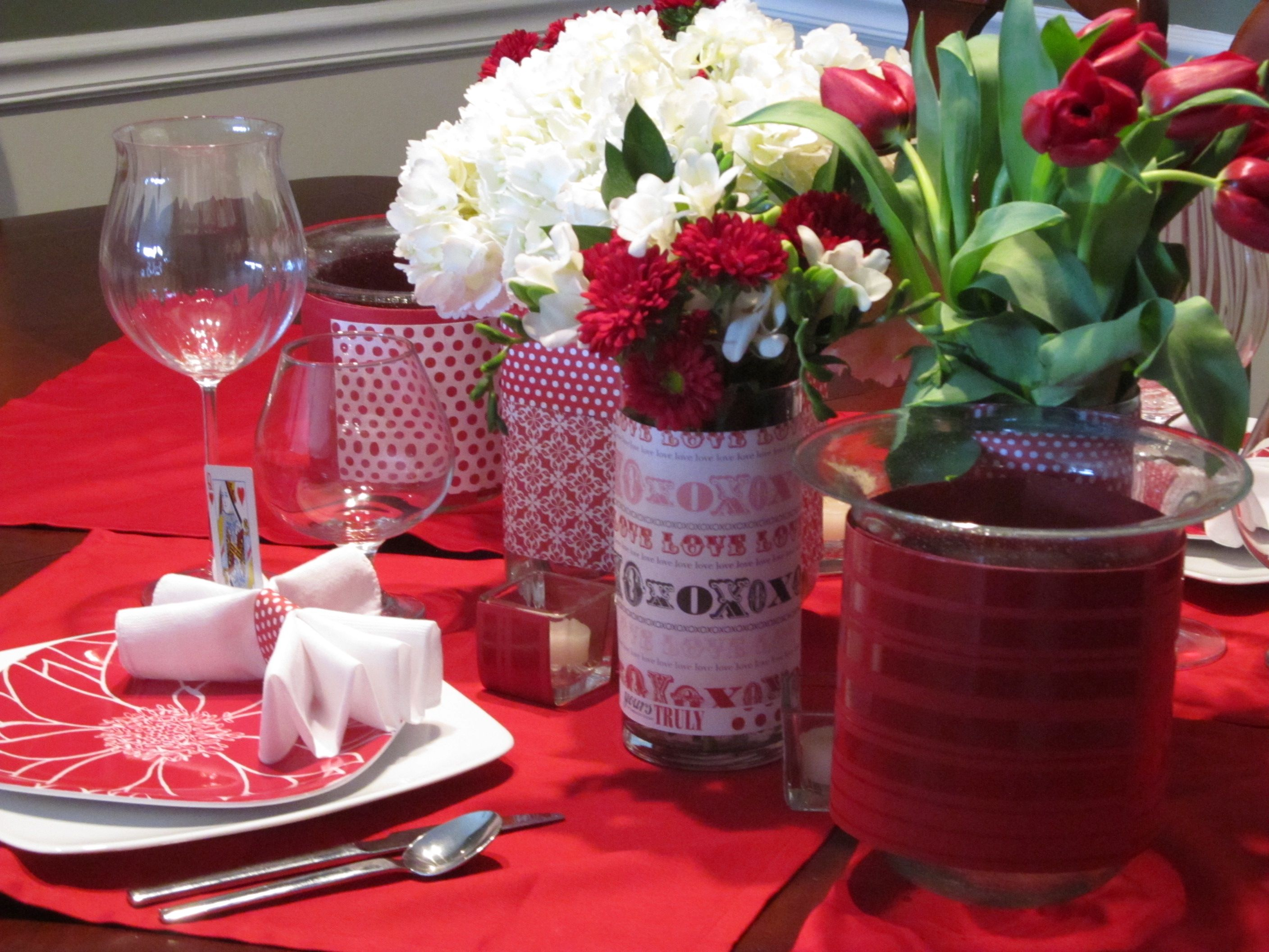 Red linens encore the go to pot table tops and treasures lovely valentines table decoration ideas with simple and beautiful flower arrangement in creative vase and red placemats table cloth for valentines table izmirmasajfo