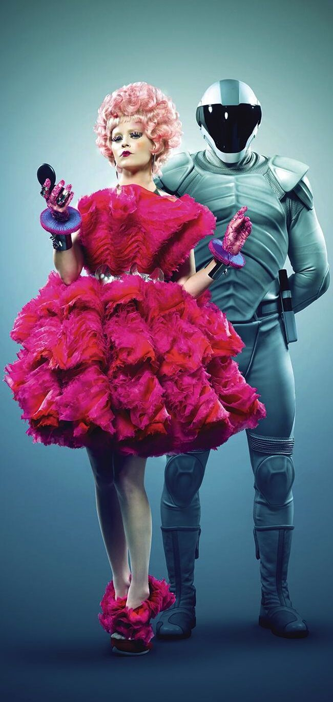 Effie Trinket and a Peacekeeper from 'Catching Fire' (2013). Costume Designer: Trish Summerville