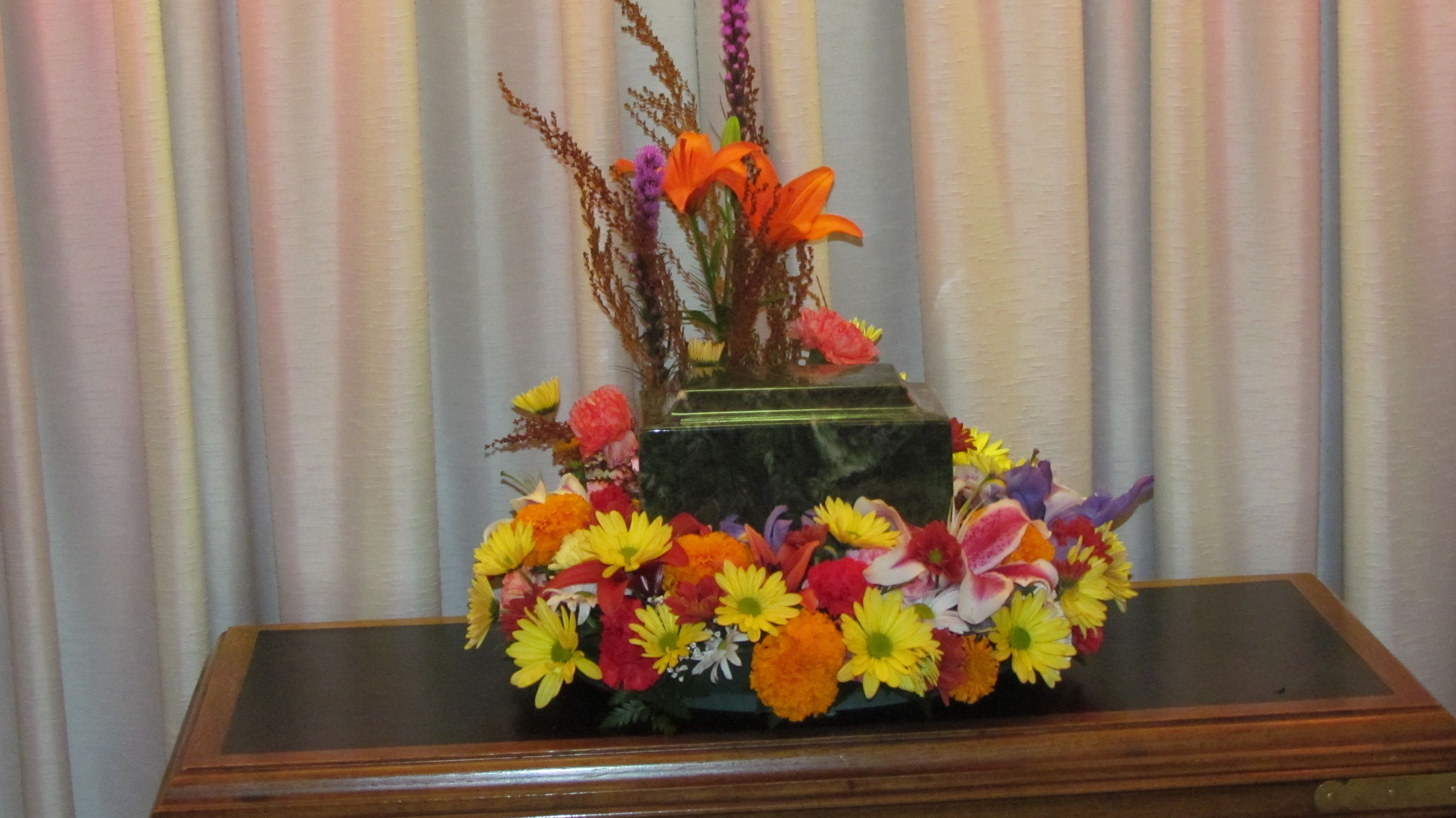 A Circle Of Flowers Will Soften The Funeral Setting And Give Some
