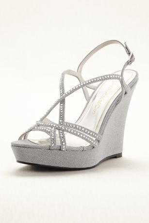 ad4022459b0 Spice up your look with these dazzling high heel wedges! Caparros strappy  high heel wedge sandals with crystal embellisment. Heel height  Fully lined.
