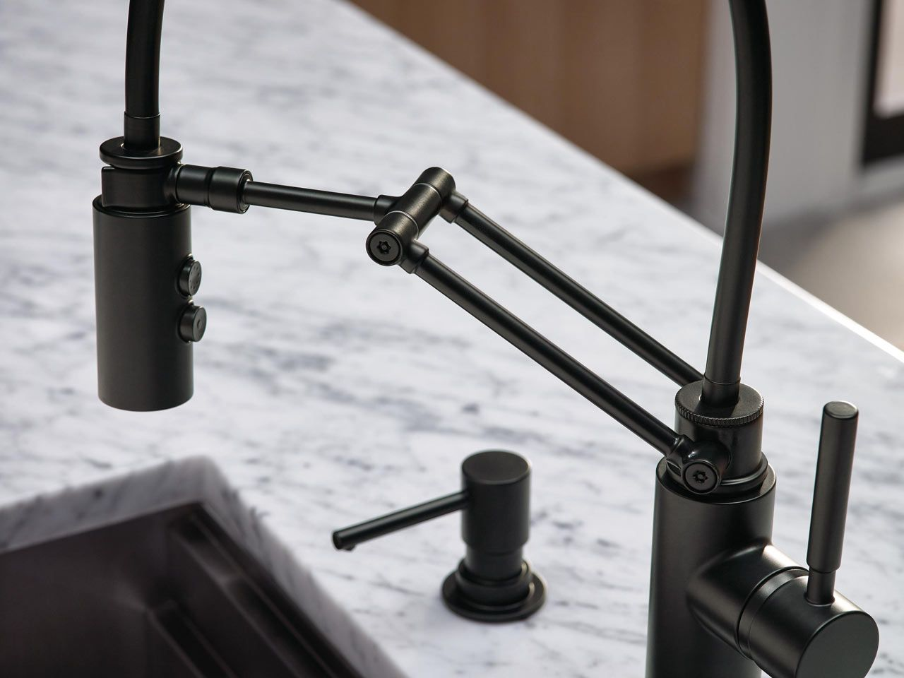 A kitchen faucet that works hard and looks good doing it design milk