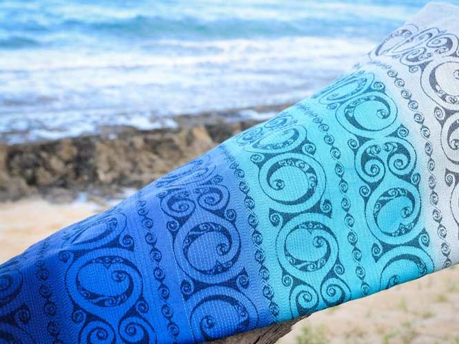 b6fc85083921 Eire Kehena baby wrap close up design photograph on the beach in Hawaii.