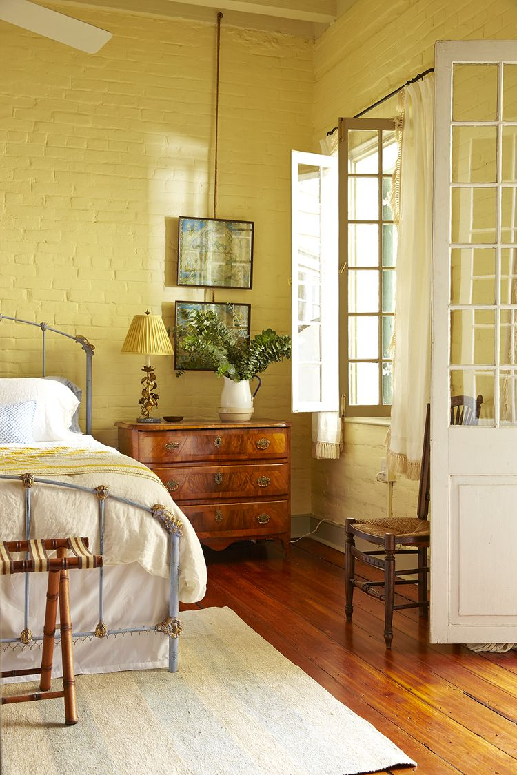 Love the yellow painted brick and old French Doors in this wonderful ...