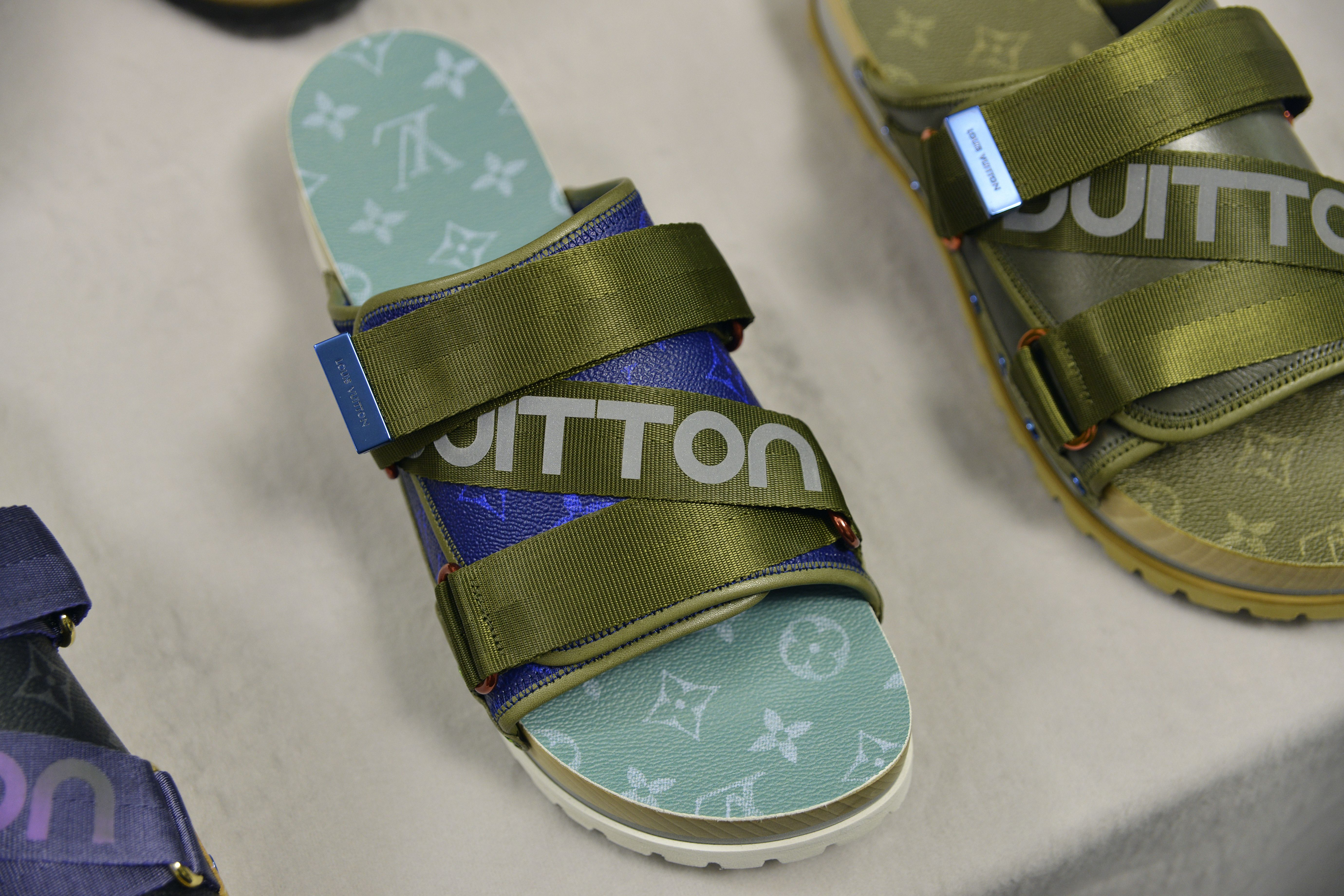 20904e882dec8 ... Gucci Men - Rubber slide sandal - 308234GIB101098 factory outlets fa4f4  2dcdd  Closer look at the details from the Louis Vuitton Spring-Summer 2018  ...