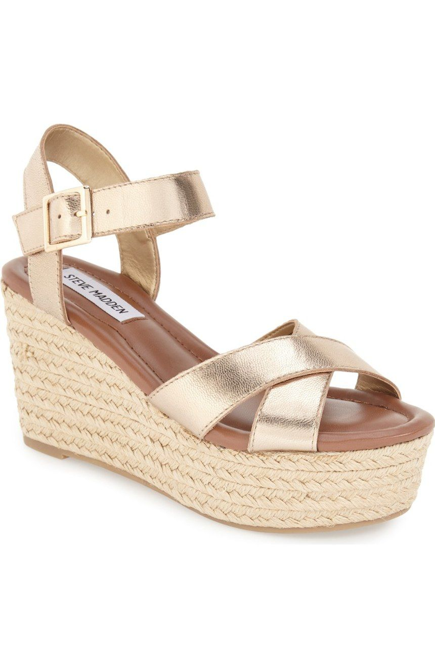 An espadrille platform wedge grounds this gold strappy leather sandal from Steve  Madden. So cute