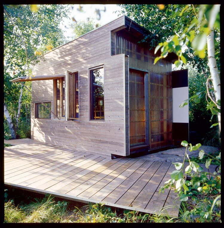 Small House Exterior Ideas: Small House The Exterior Is Clad In An Elegant Mish-mash