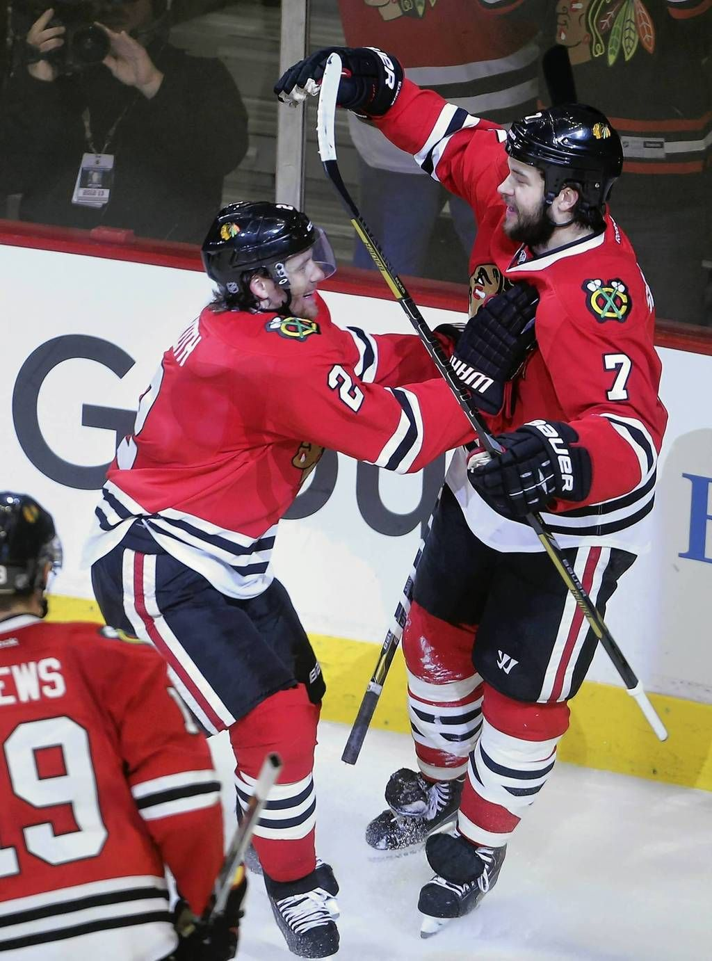 Duncan Keith and Brent Seabrook celebrate Seabrook's goal