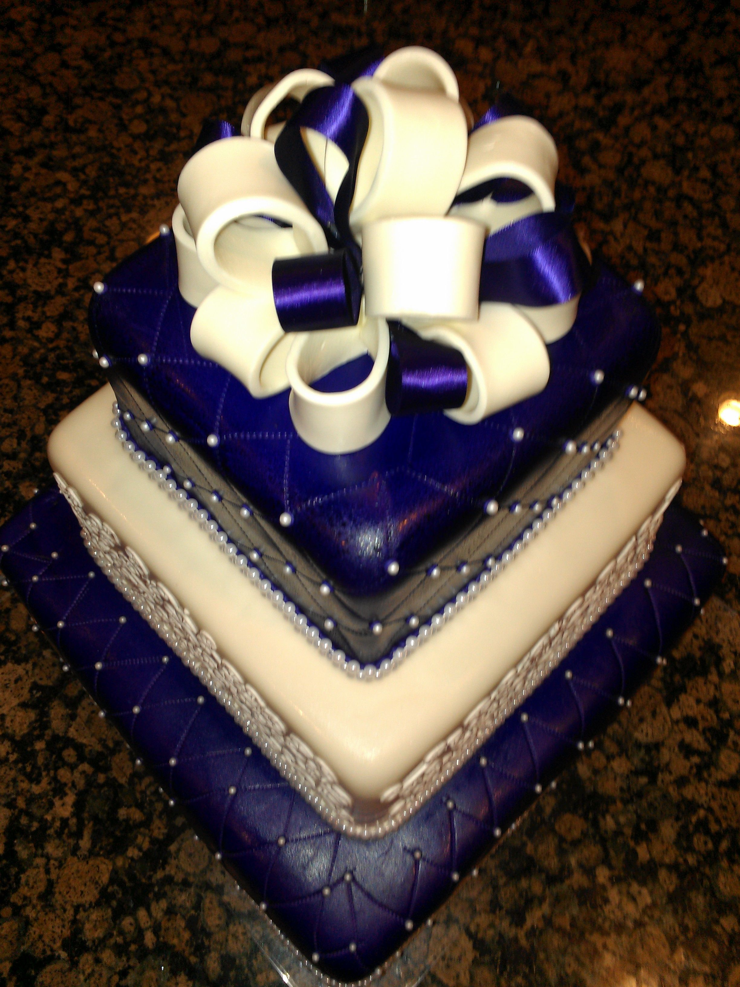- Purple and Cream Wedding Cake with Bow