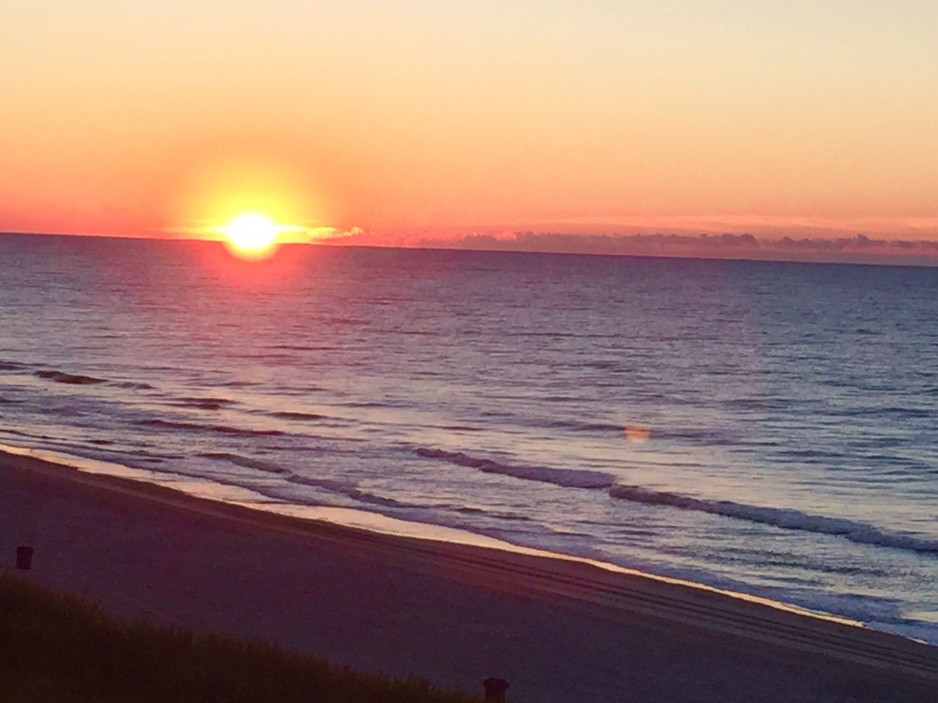 Sunrise over the Atlantic from our 5 th floor balcony, Water Pointe1 in North Myrtle Beach,SC.