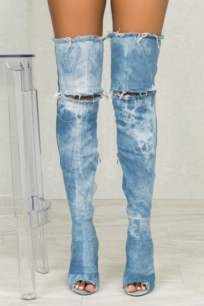 378e3c7495b Don t miss your chance to stand out in the latest denim boot. This marble  washed denim boot has a peep toe opening and slit at the knee.
