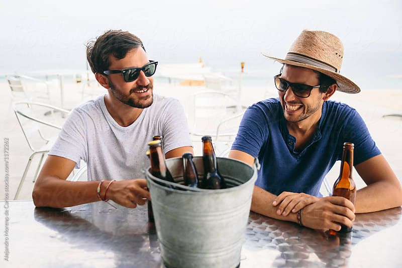 Stock Photo Of Two Young Friends Hanging Out And Enjoying Some