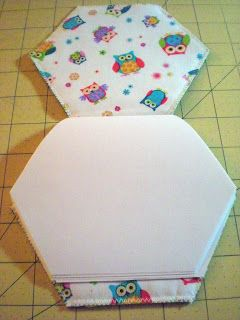 Child's scribble book with padded hexagon cover.