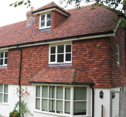 Tudor roof tile adds style and value with vertical hanging for Outside house tiles design