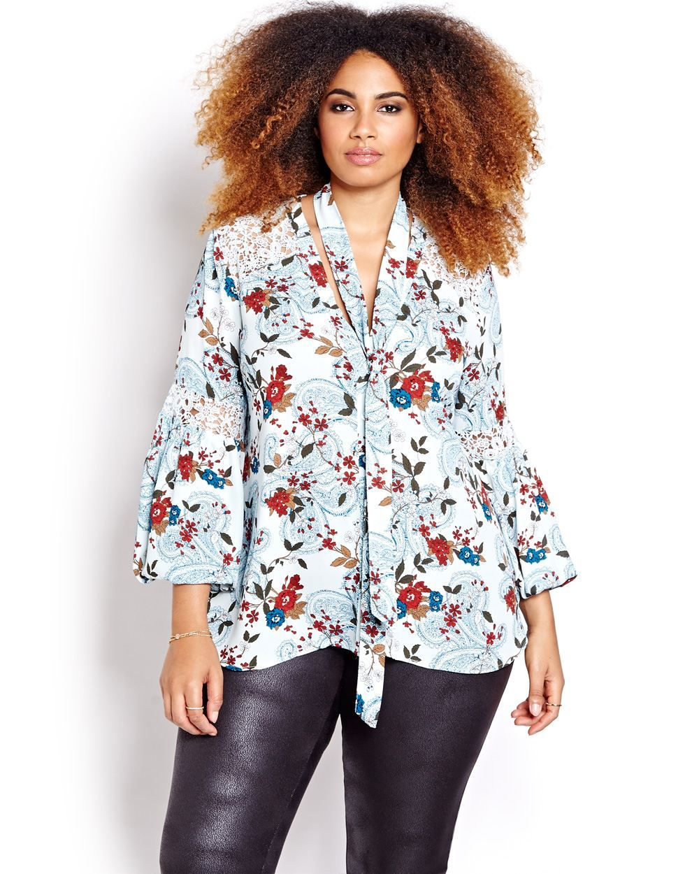A plus size blouse that features many trendy details like crochet cutouts, pope…