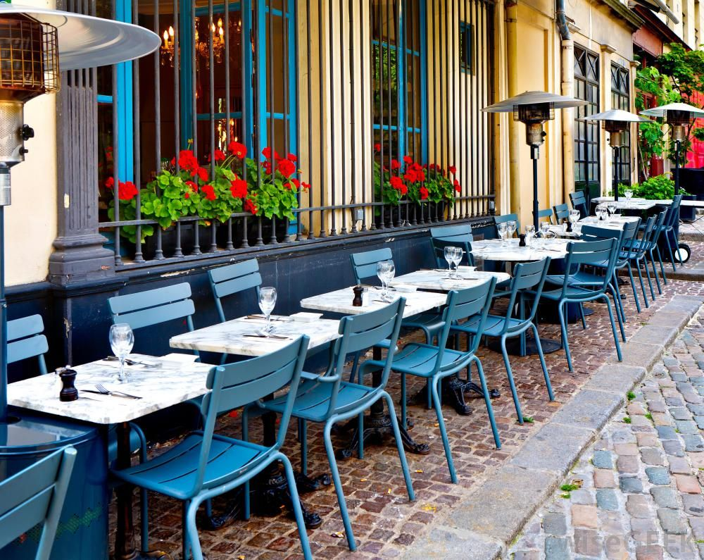 A cafe barista might work at a bistro coffee shop ideas for Outdoor furniture europe